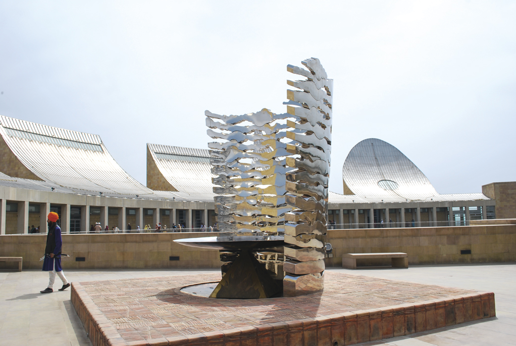 A stainless steel installation on a terracotta base
